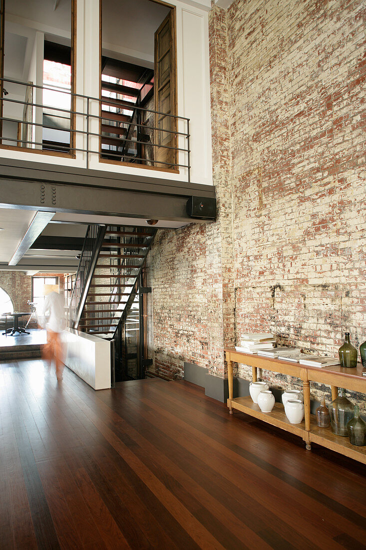 Mezzanine and staircase in industrial building repurposed as home