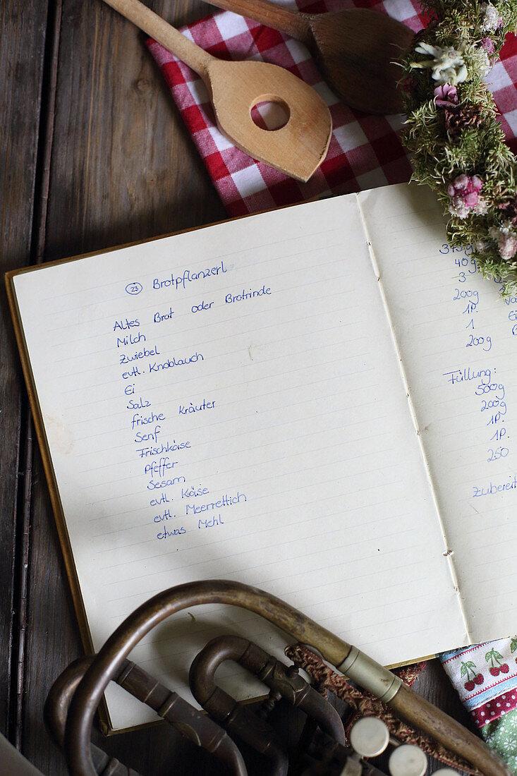 Handwritten recipe for bread patties in open book
