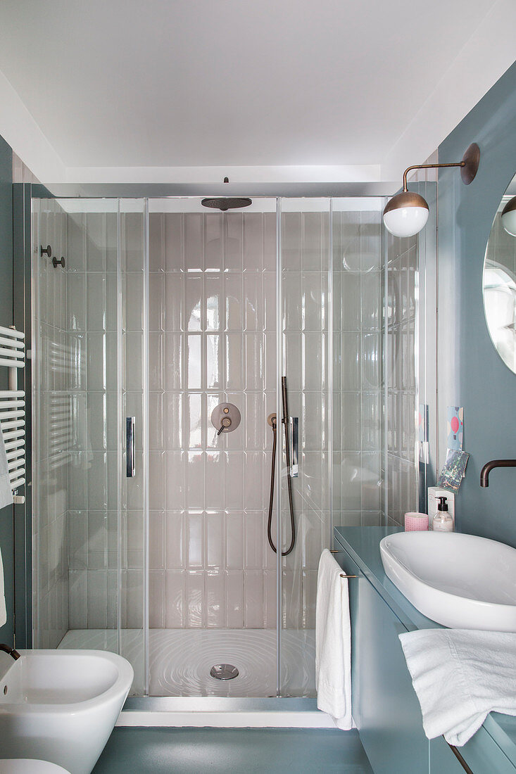 Small bathroom with shower across width of room