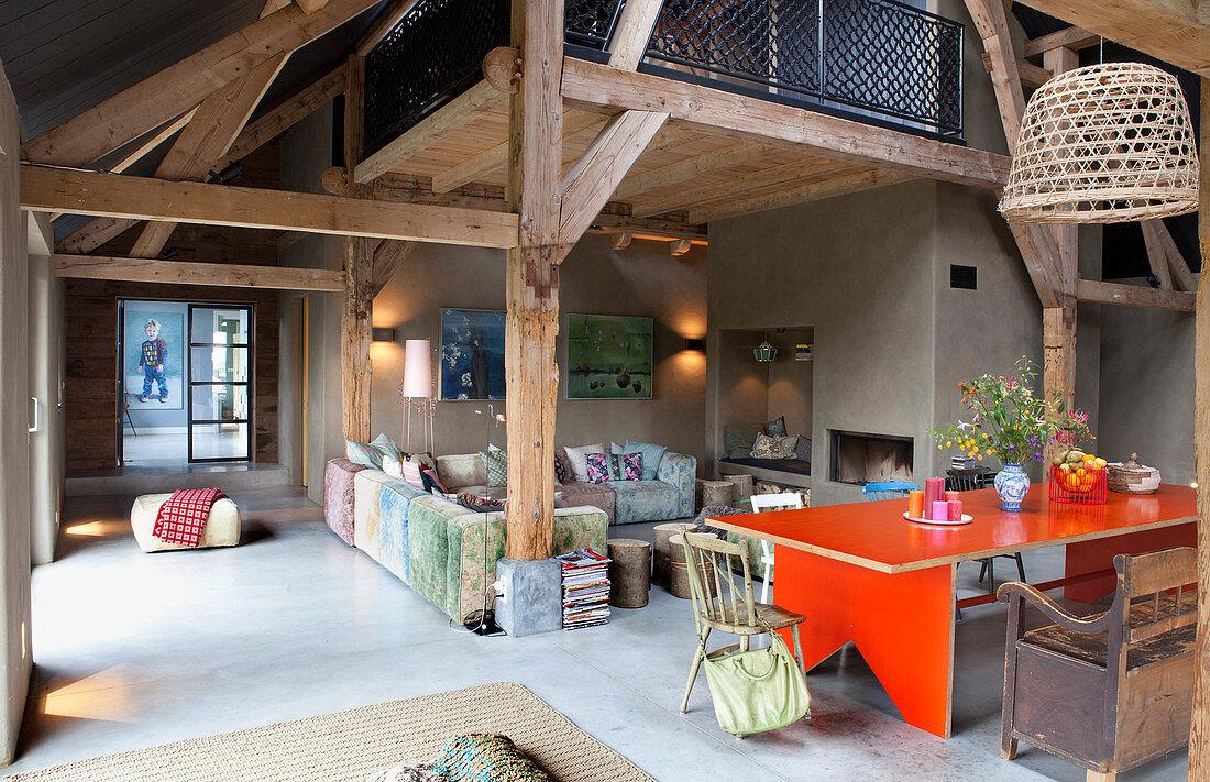 Open-plan, vintage-style interior in old farmhouse