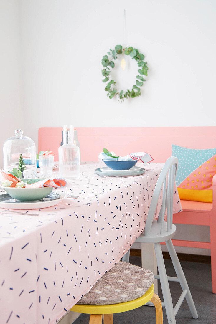 Table set in feminine pastel shades for Christmas dinner