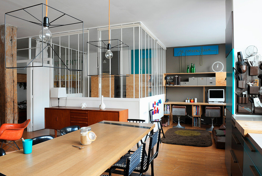 Dining area, study and bedroom with glass partition walls in loft apartment