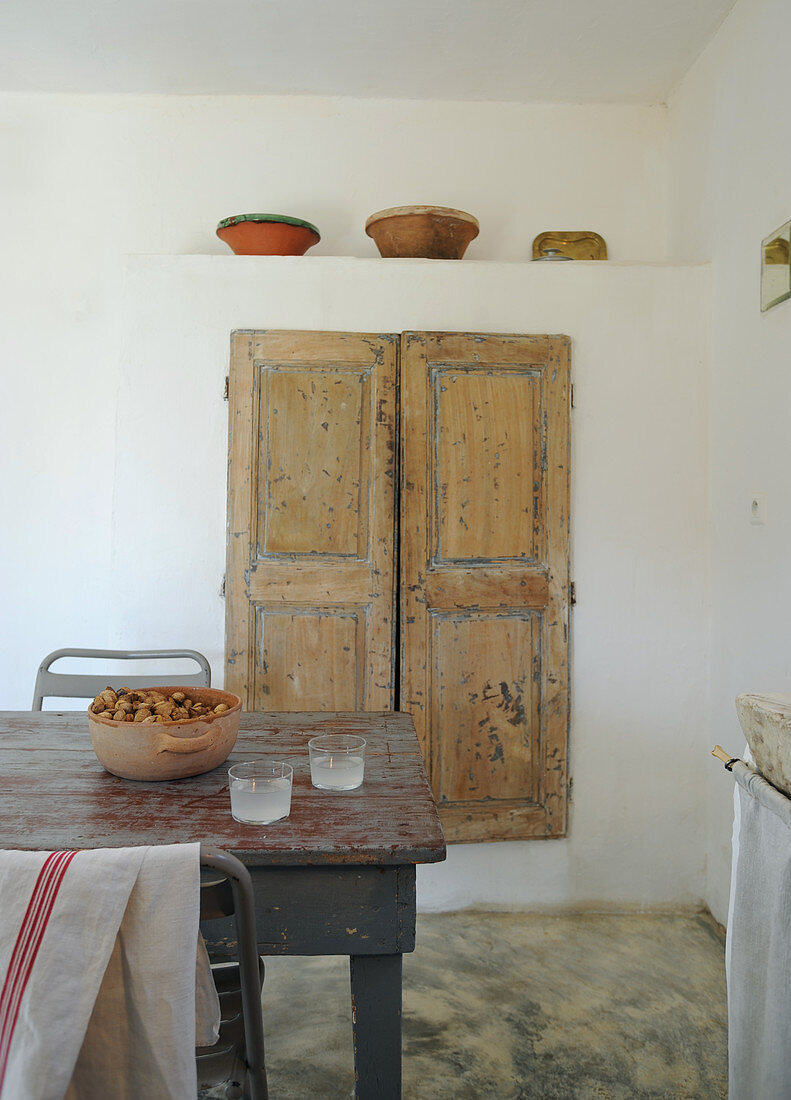 Fitted cupboard and dining room in rustic kitchen-dining room