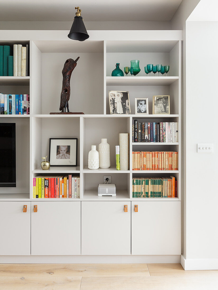 Fitted, white shelving with cupboards below