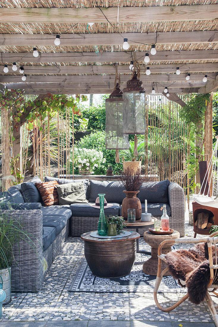 Rattan outdoor furniture below pergola