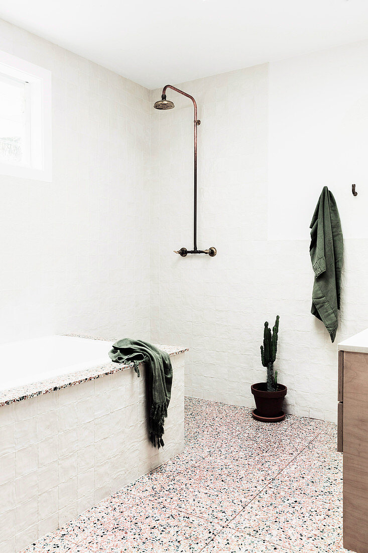 Minimalist bathroom with a natural, rustic look