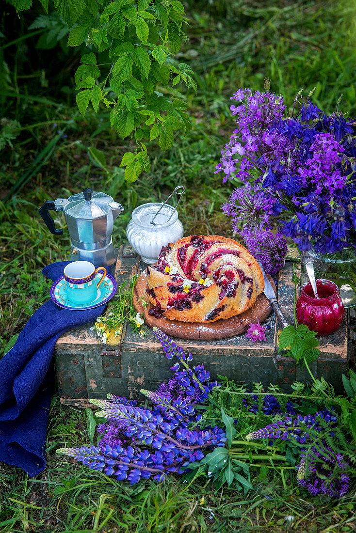 Bundt cake with berries in garden