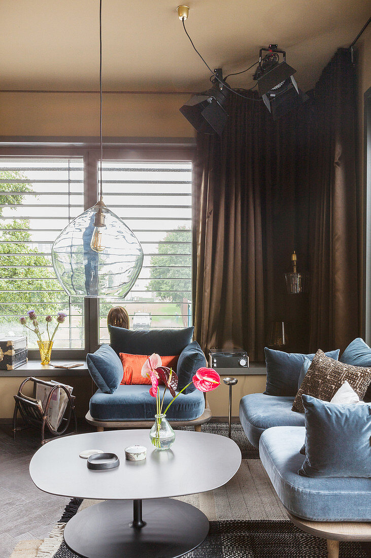 Sofa and armchair with blue velvet covers in living room