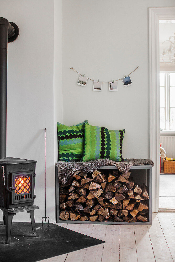 Log burner and bench with firewood store below