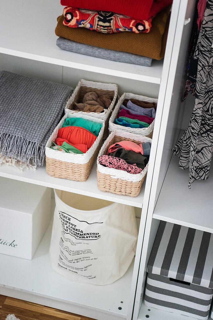 Storage baskets on open shelves in dressing room