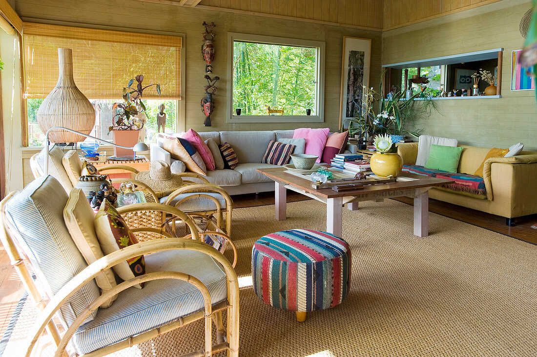 Ethnic accessories in living room in earthy shades