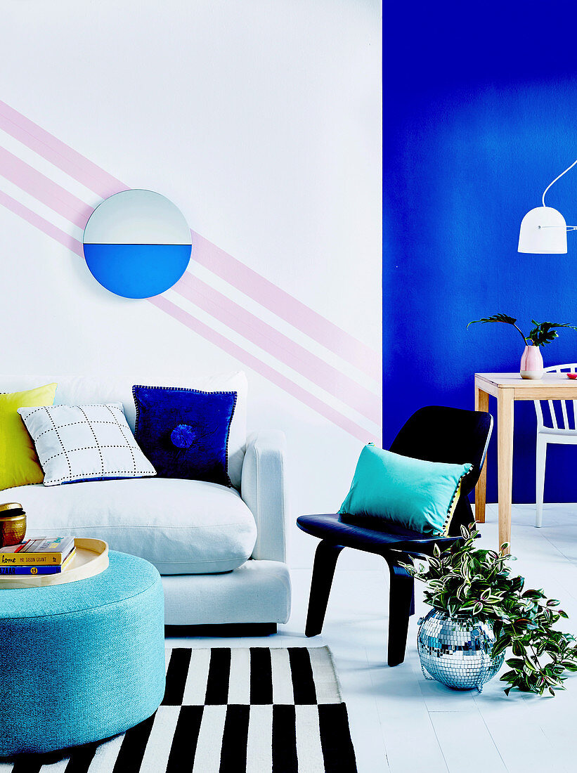 Living and dining room with strong colors and graphic patterns