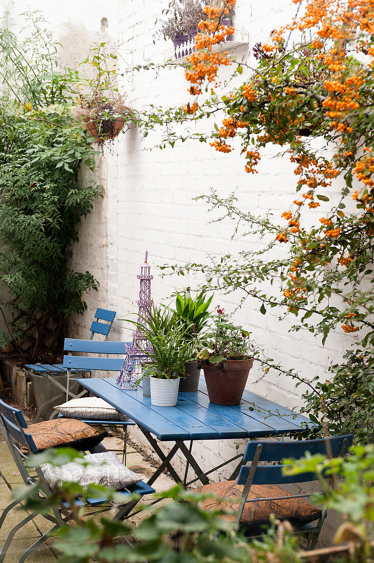 Blue garden furniture against wall
