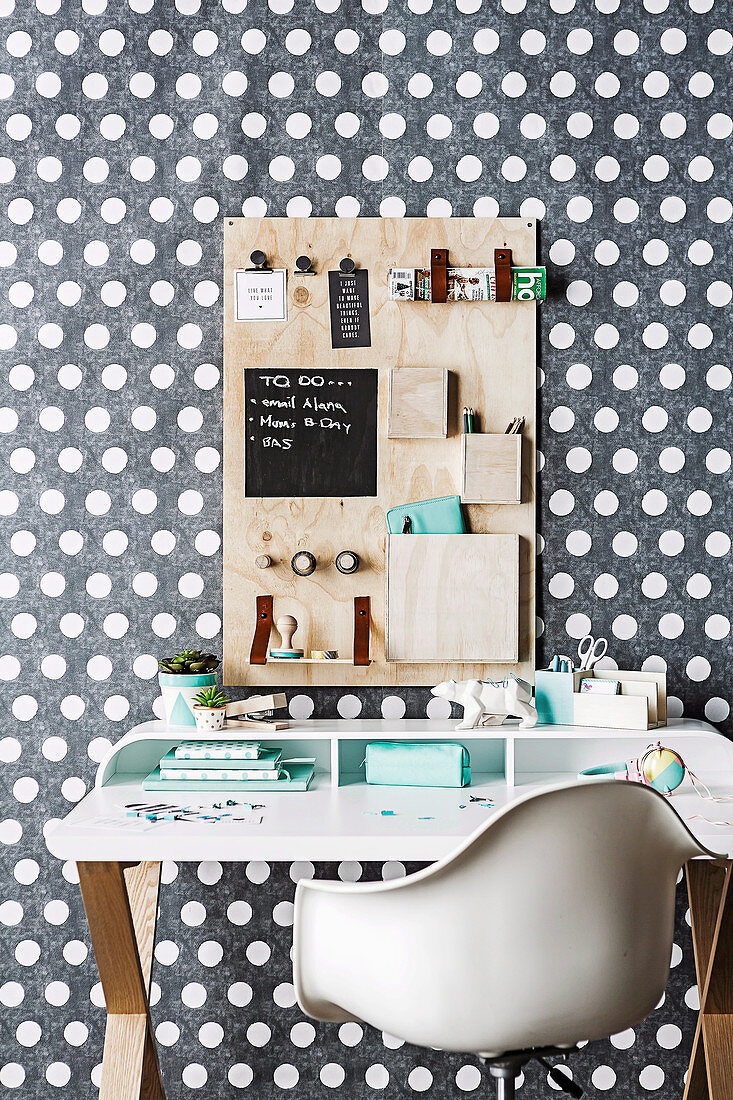 DIY pin board over desk with white shell chair