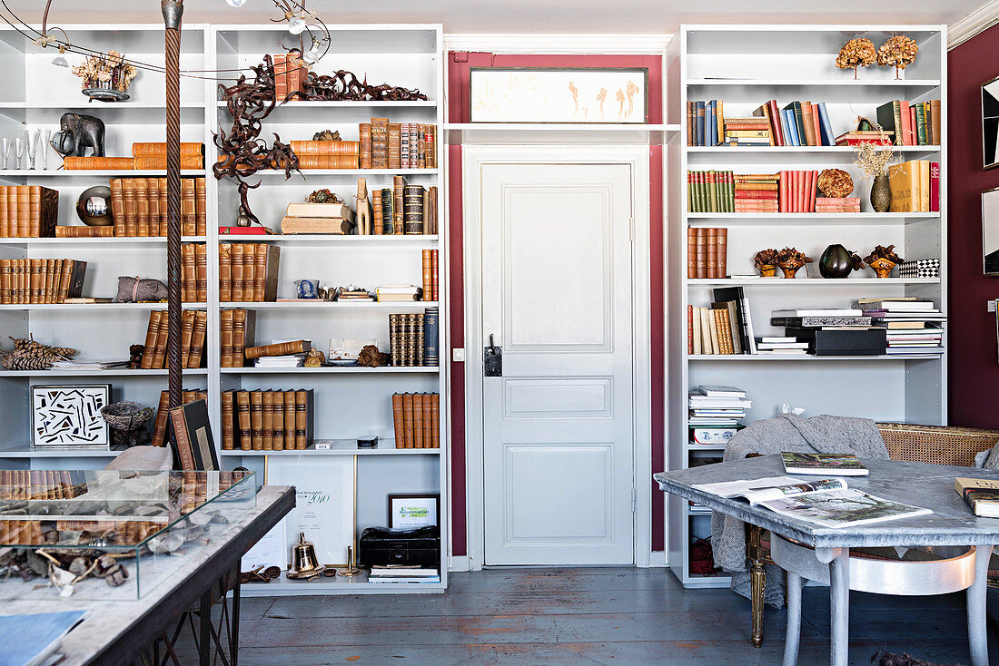 Floor-to-ceiling bookcases and tables in study