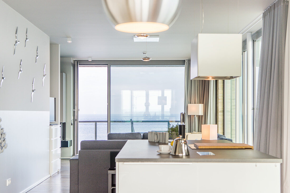 Sea view through floor-to-ceiling windows seen from kitchen
