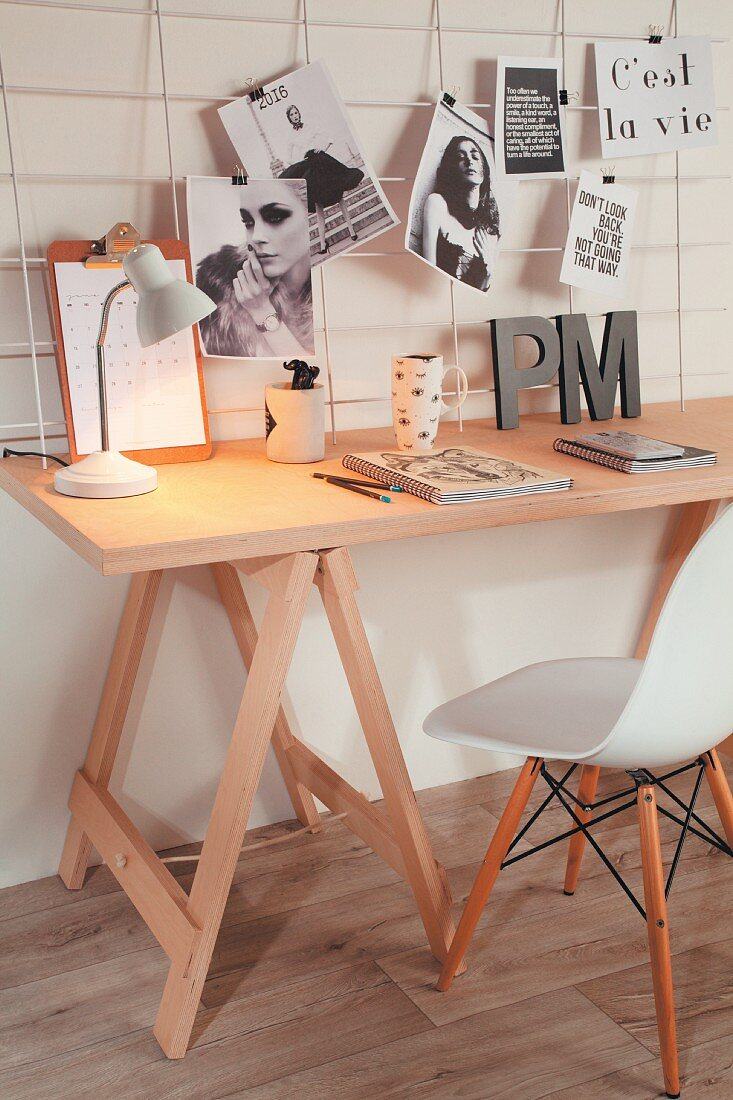 Desk on trestles and wire mesh pinboard
