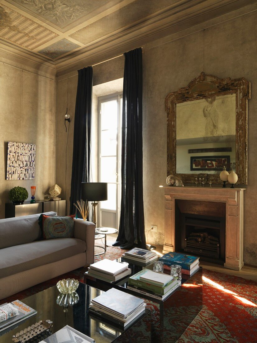 Antique and modern furniture in living room with ceiling fresco