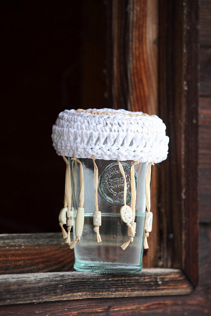 Crocheted raffia jam jar lid
