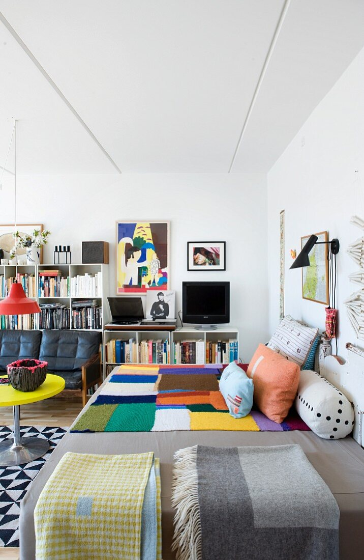 Eclectic mixture of styles and graphic patterns in living room