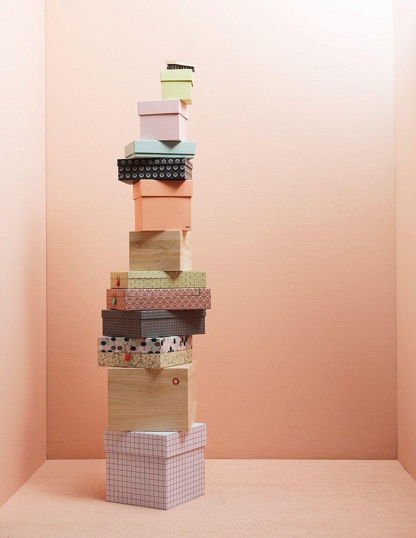 Various storage boxes against pink wall