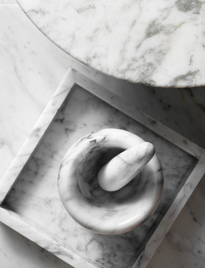 Mortar and pestle, dish and table top made from white marble