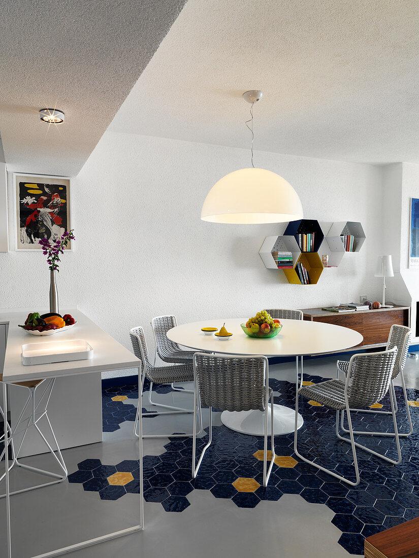 Open-plan kitchen and dining room with blue hexagonal floor tiles