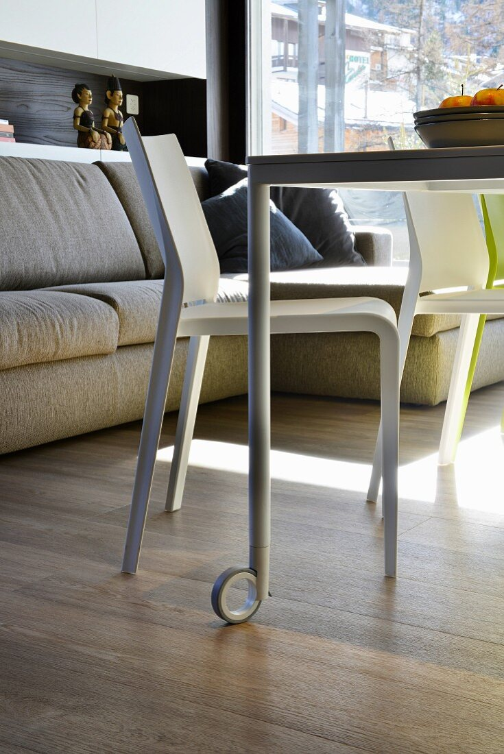 Dining table on castors in multifunctional room