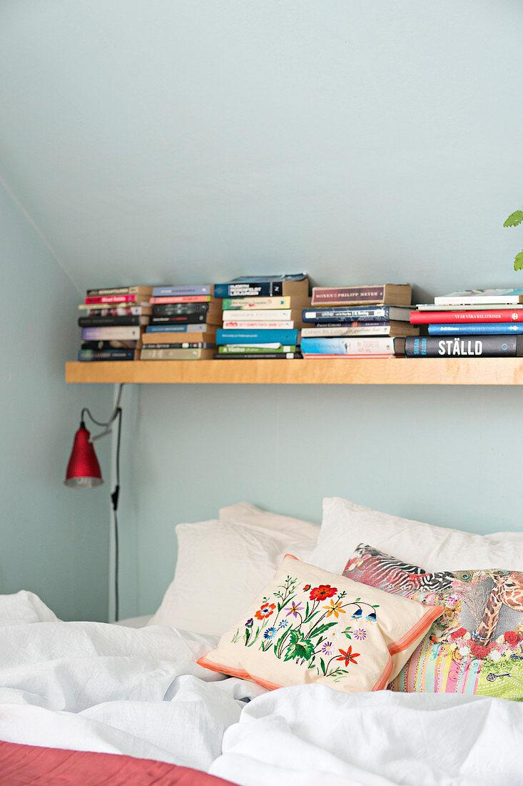 Books On Shelf Above Bed Under Sloping Buy Image 12315429 Living4media