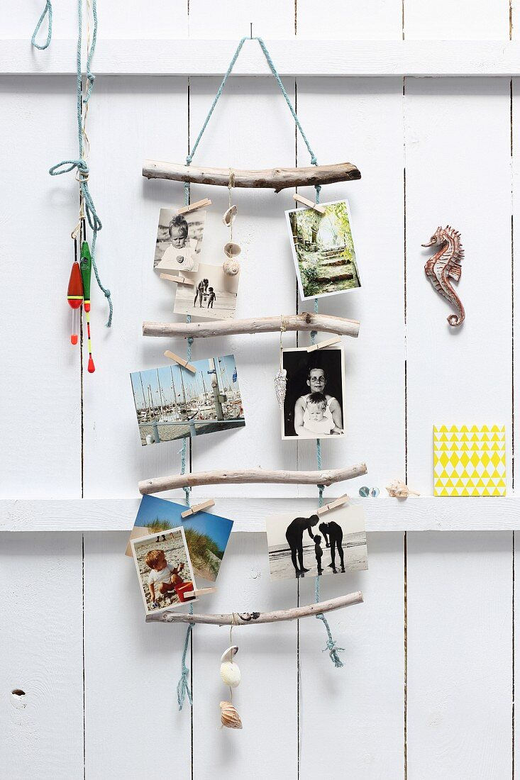 Holiday photos hung from rope ladder with driftwood rungs