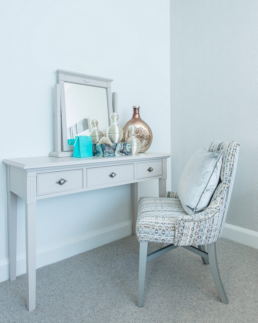 Dressing table with mirror and upholstered chair