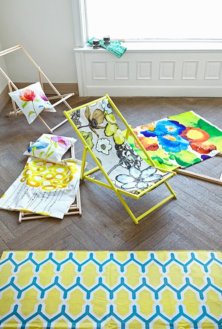 Floral-patterned fabrics for a deckchair and cushions