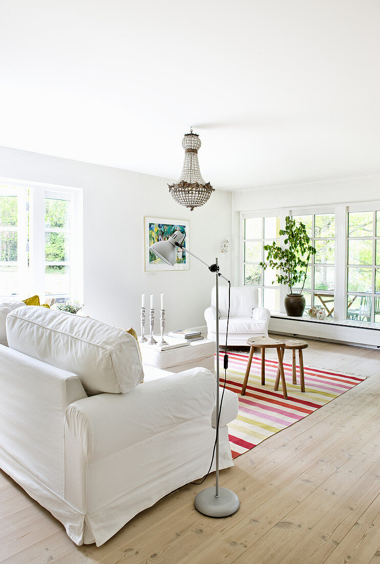 Brightly striped rug in white living room