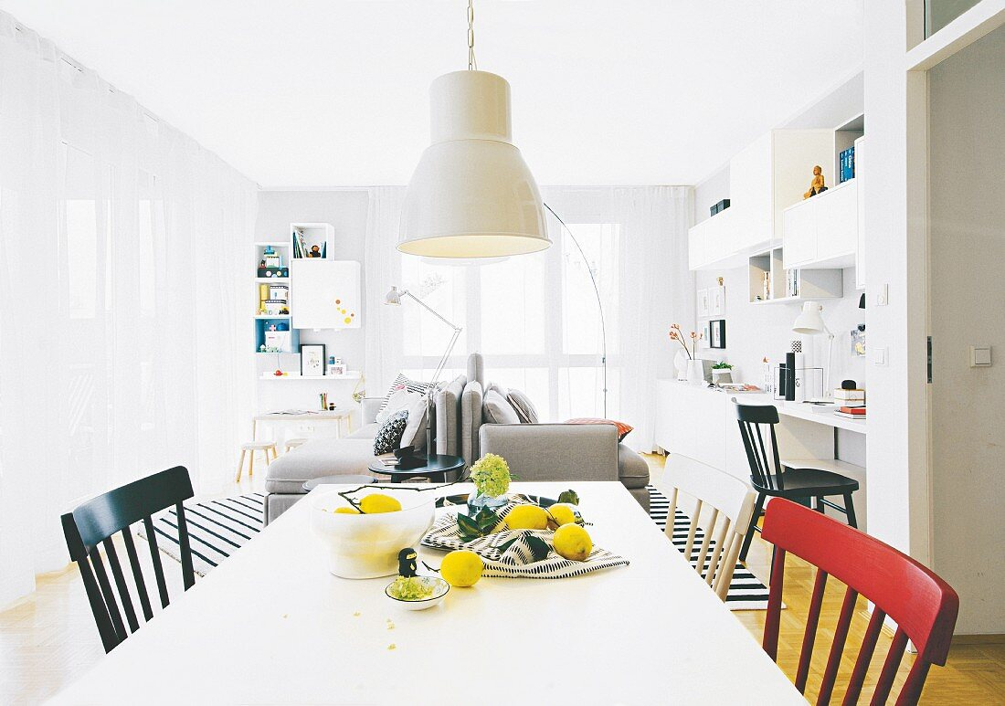 A dining table and chairs in an open-plan living area