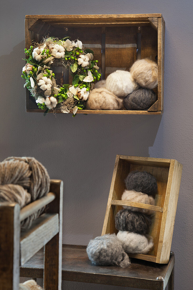 Wreath with cotton bolls in wooden crate hung on wall