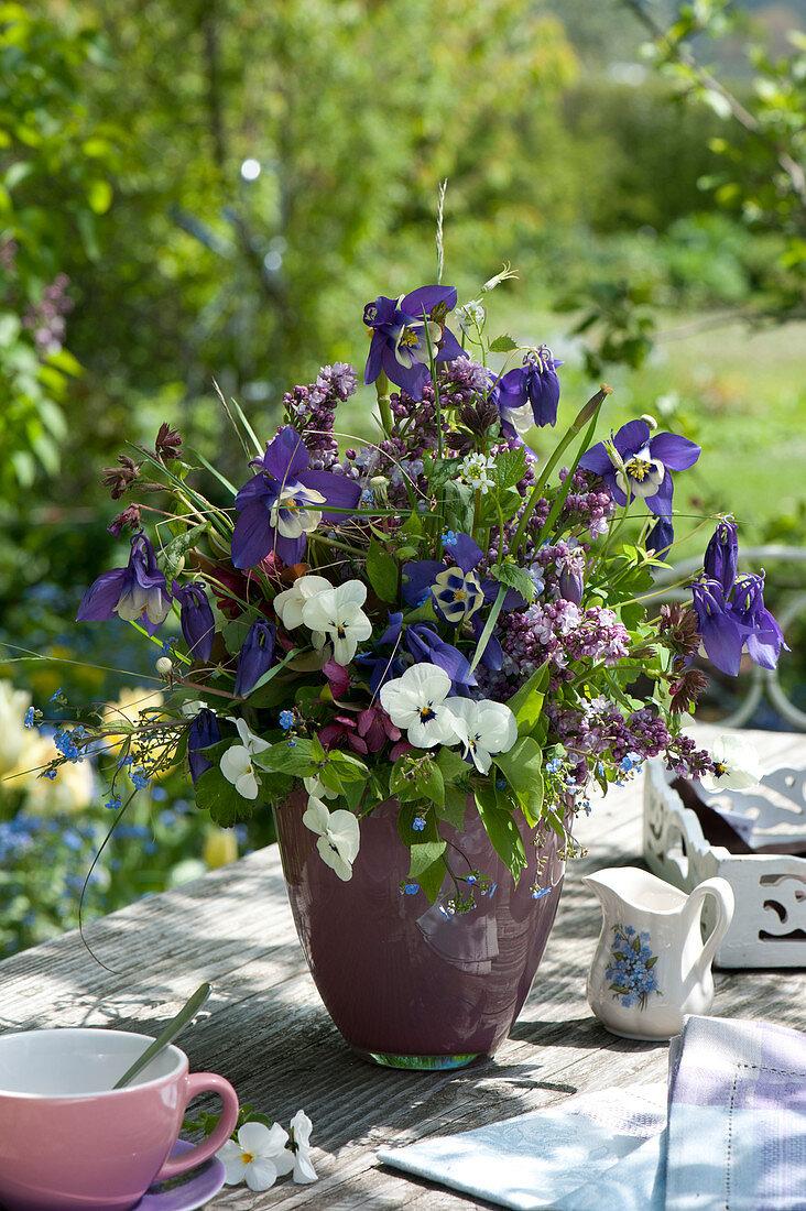 Fragrant spring bouquet, Aquilegia, Syringa, Viola
