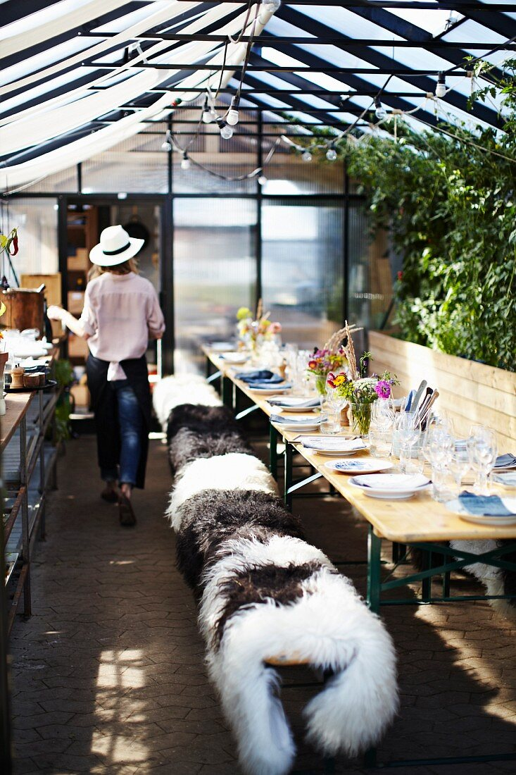 Cook in roof garden restaurant Stedsans, Ostergro, Copenhagen, Denmark