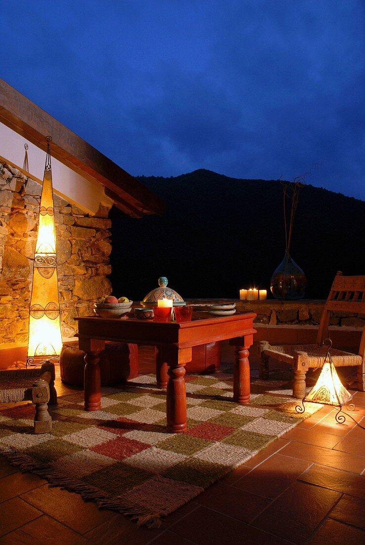 Oriental standard lamp on twilight terrace