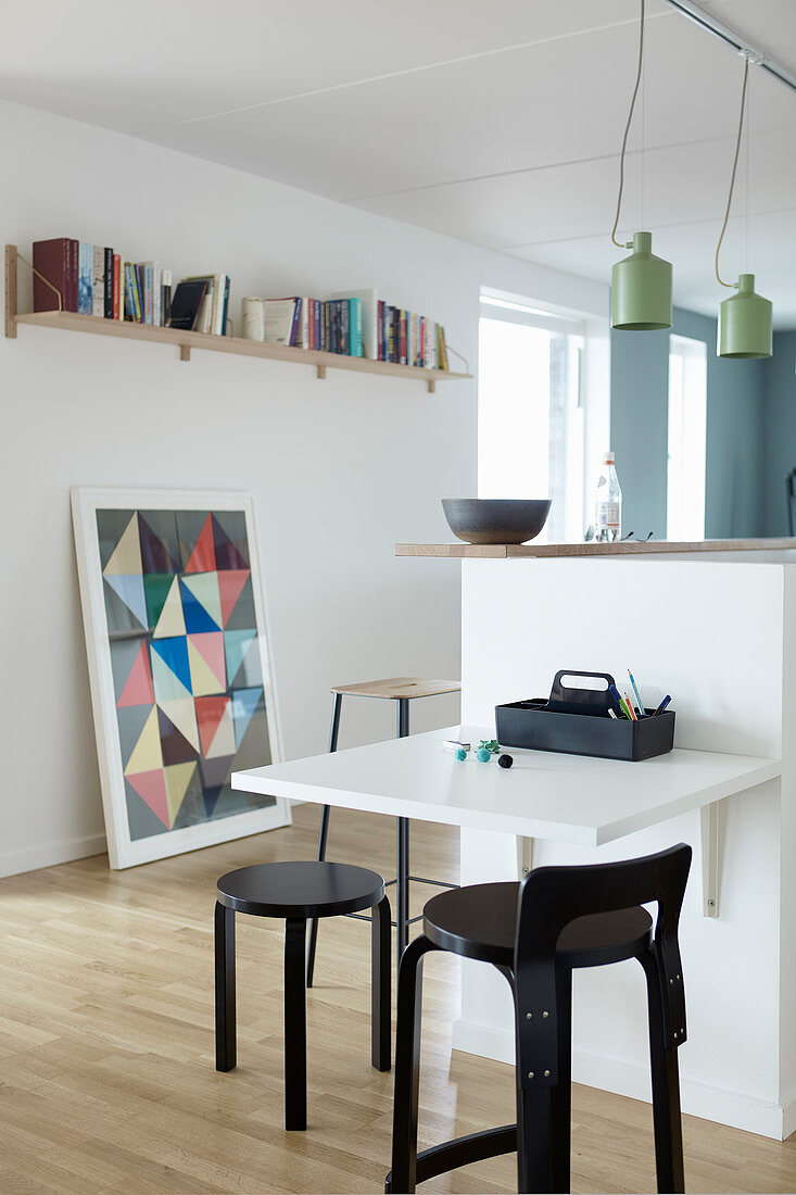 Child's table on end of half-height partition wall in kitchen