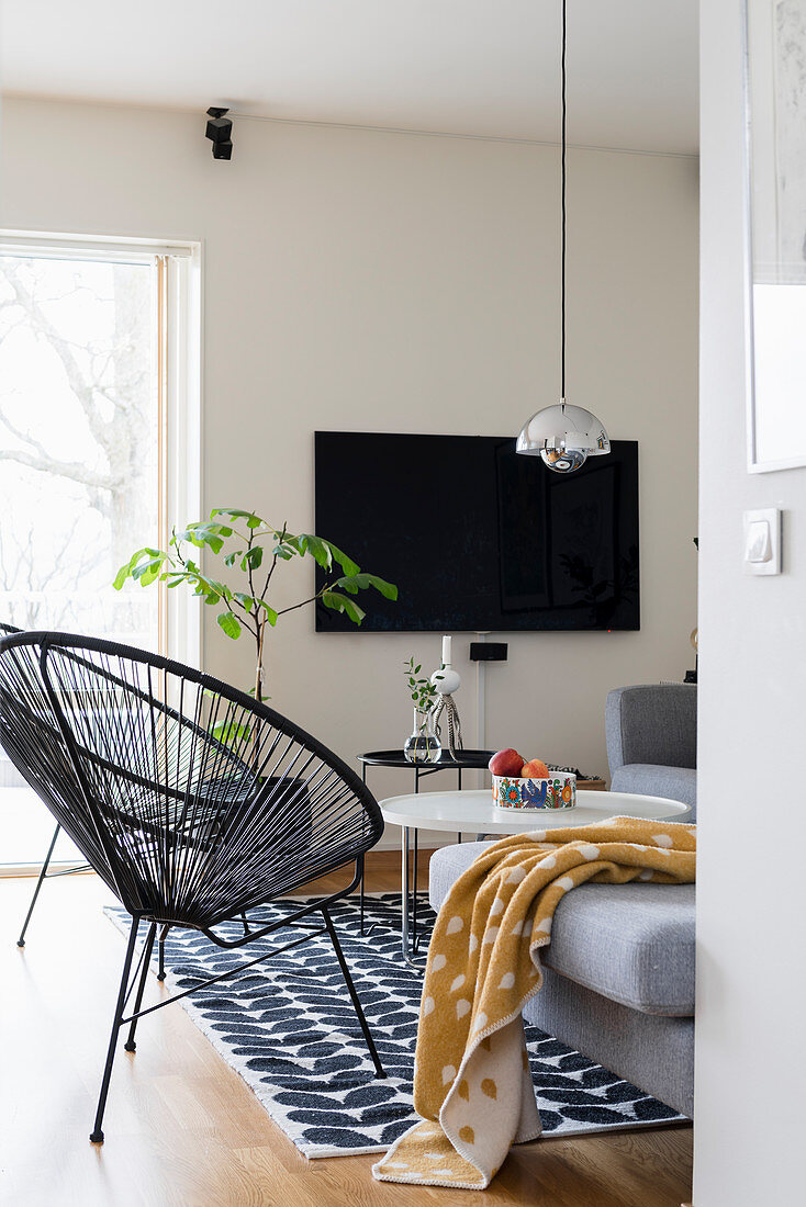 Classic chair, coffee table, grey sofa and TV in living room