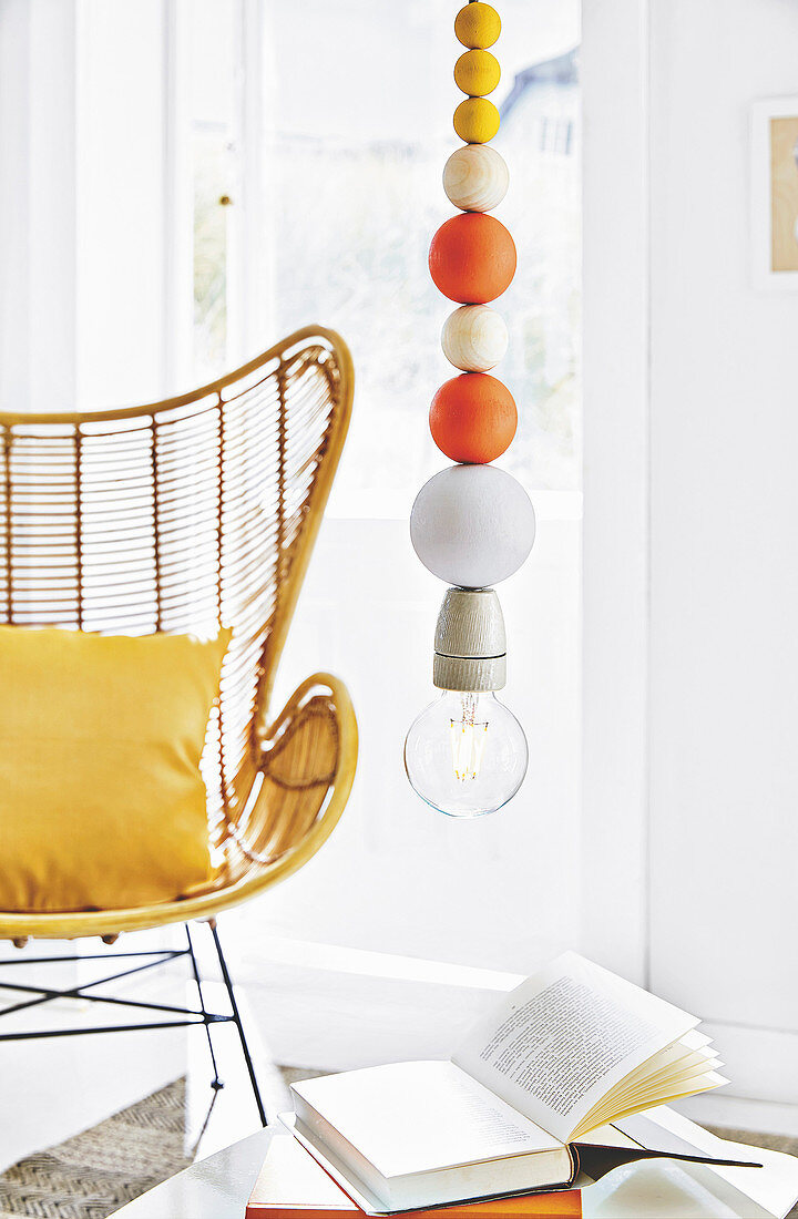 A homemade pendant light made from colourful wooden balls