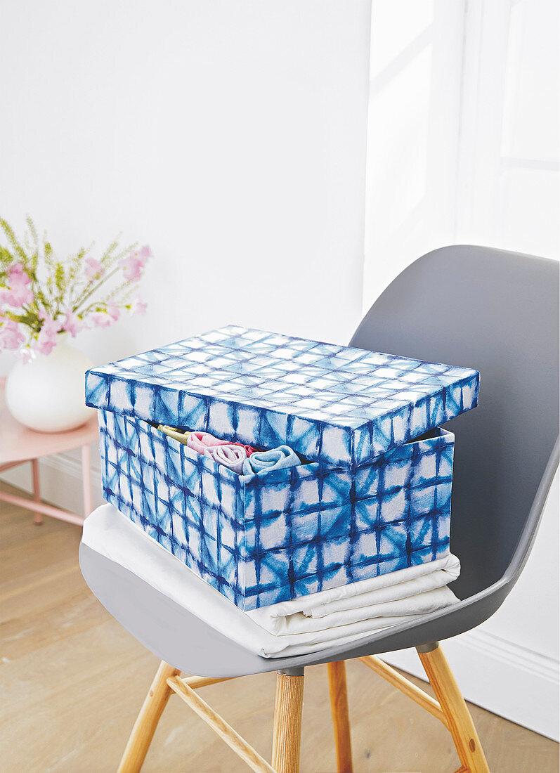 Cardboard box covered in batik fabric