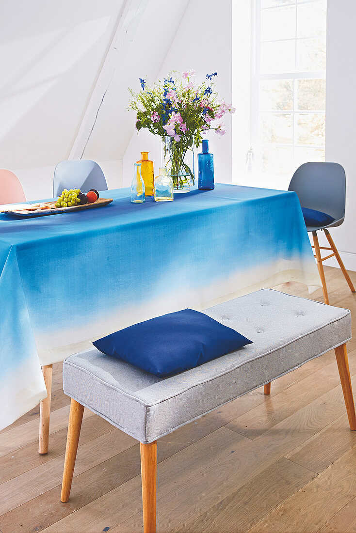 A homemade tablecloth with a blue colour gradient
