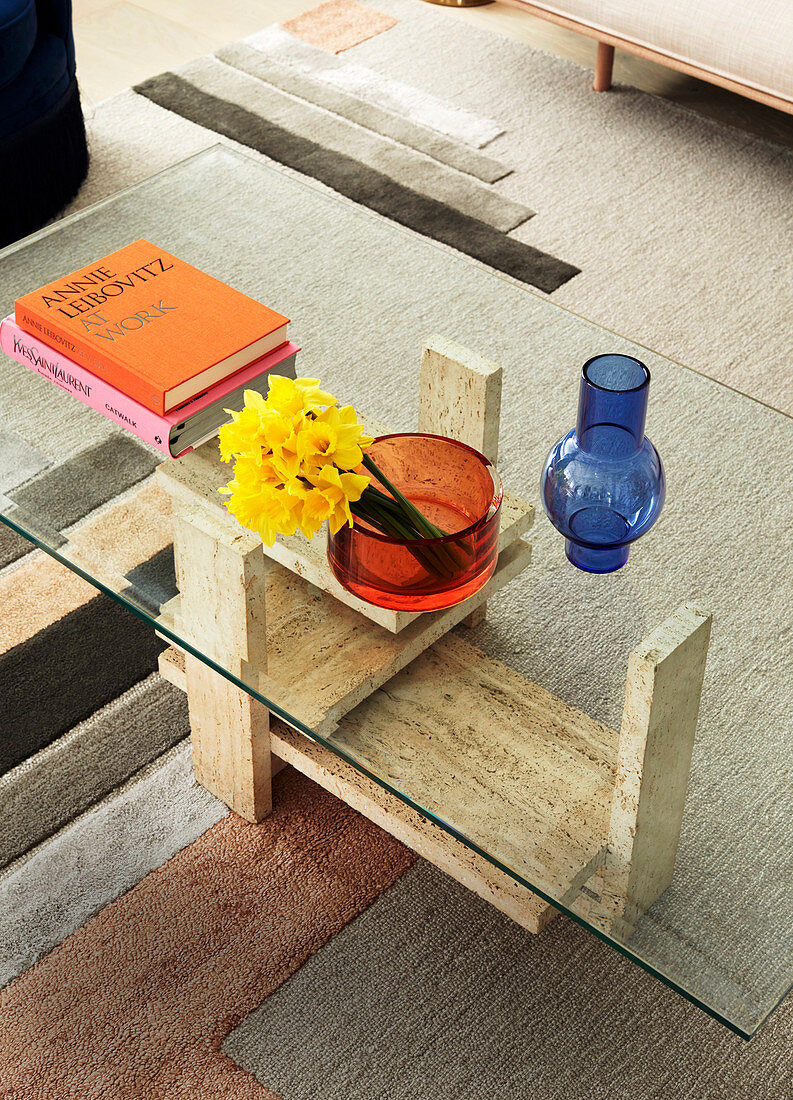 Coffee table with travertine frame and glass top