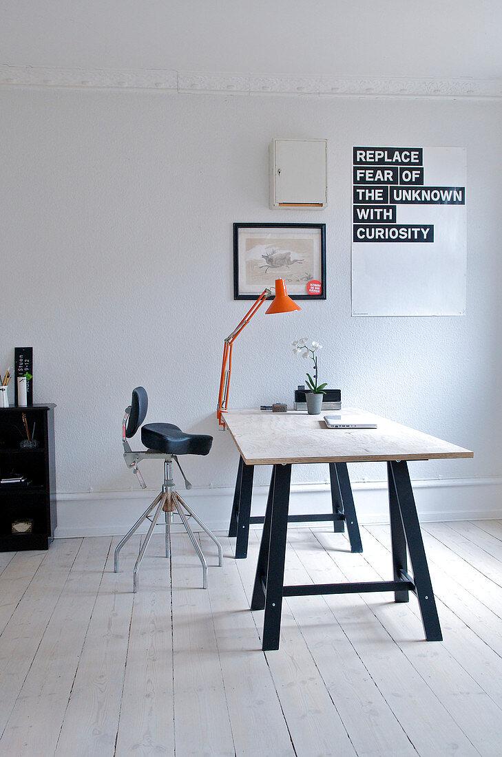Desk on trestle legs in a minimalist study
