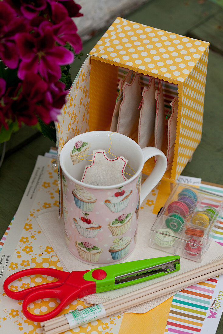 Box of handmade, dress-shaped teabags