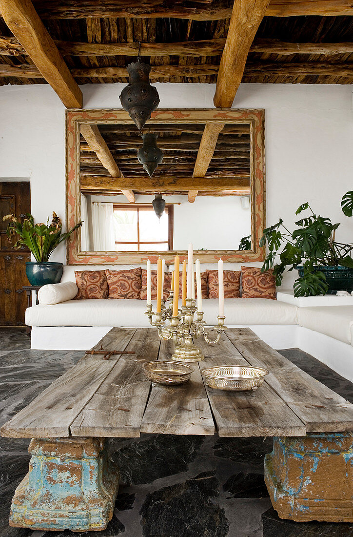 An old wooden door on capitals as a coffee table in a Mediterranean living room