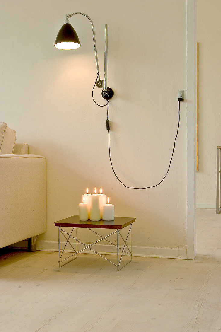 black hanging pendant lamp in a room with warm white tones