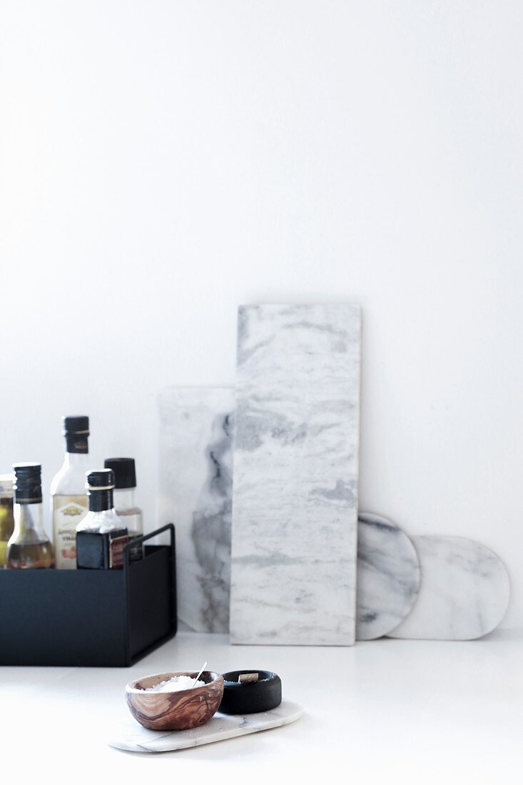 Marble boards and condiments in black metal box