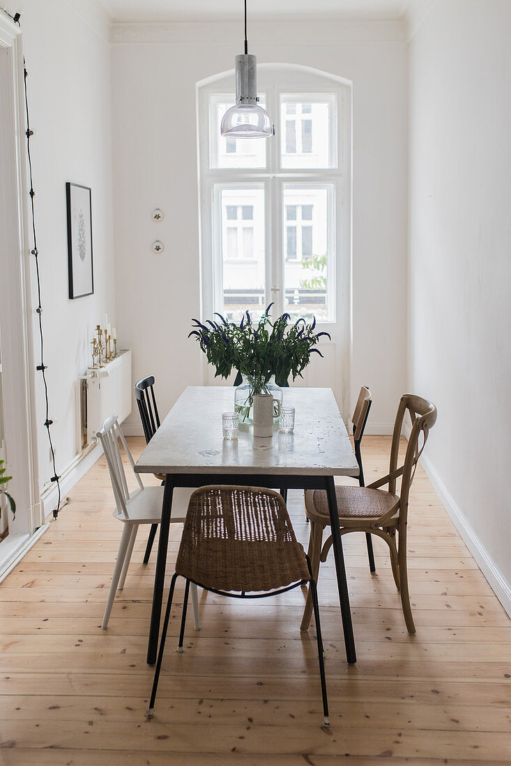 Various chairs in minimalist dining room